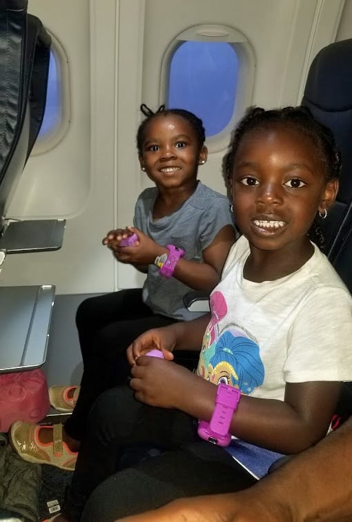 Two girls playing with playdoh on a Spirit Airlines Flight - how to avoid extra fees when flying spirit airlines 8