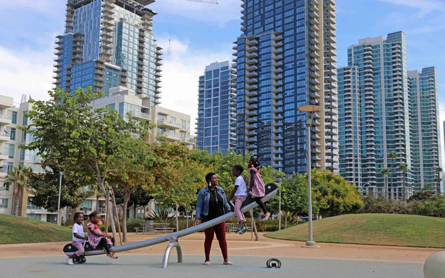 Family playing in Waterfront Park in San Diego