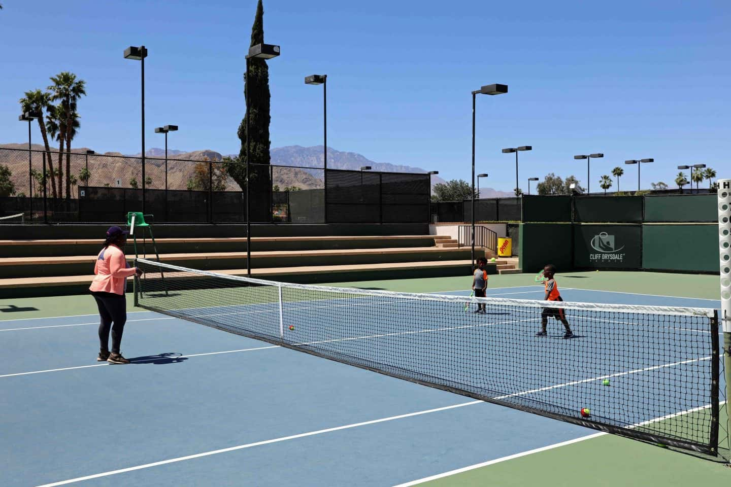family playing tennis in Palm Springs - how to vacation in palm springs with kids