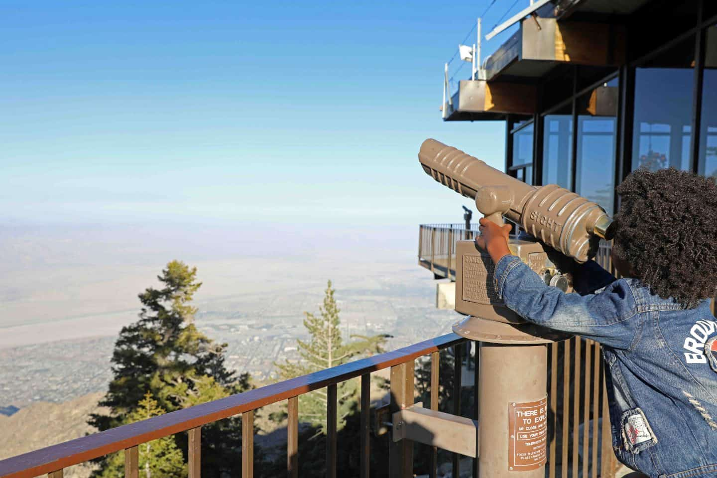 Viewing the distance through a telescope from the Palm Springs Aerial Tramway