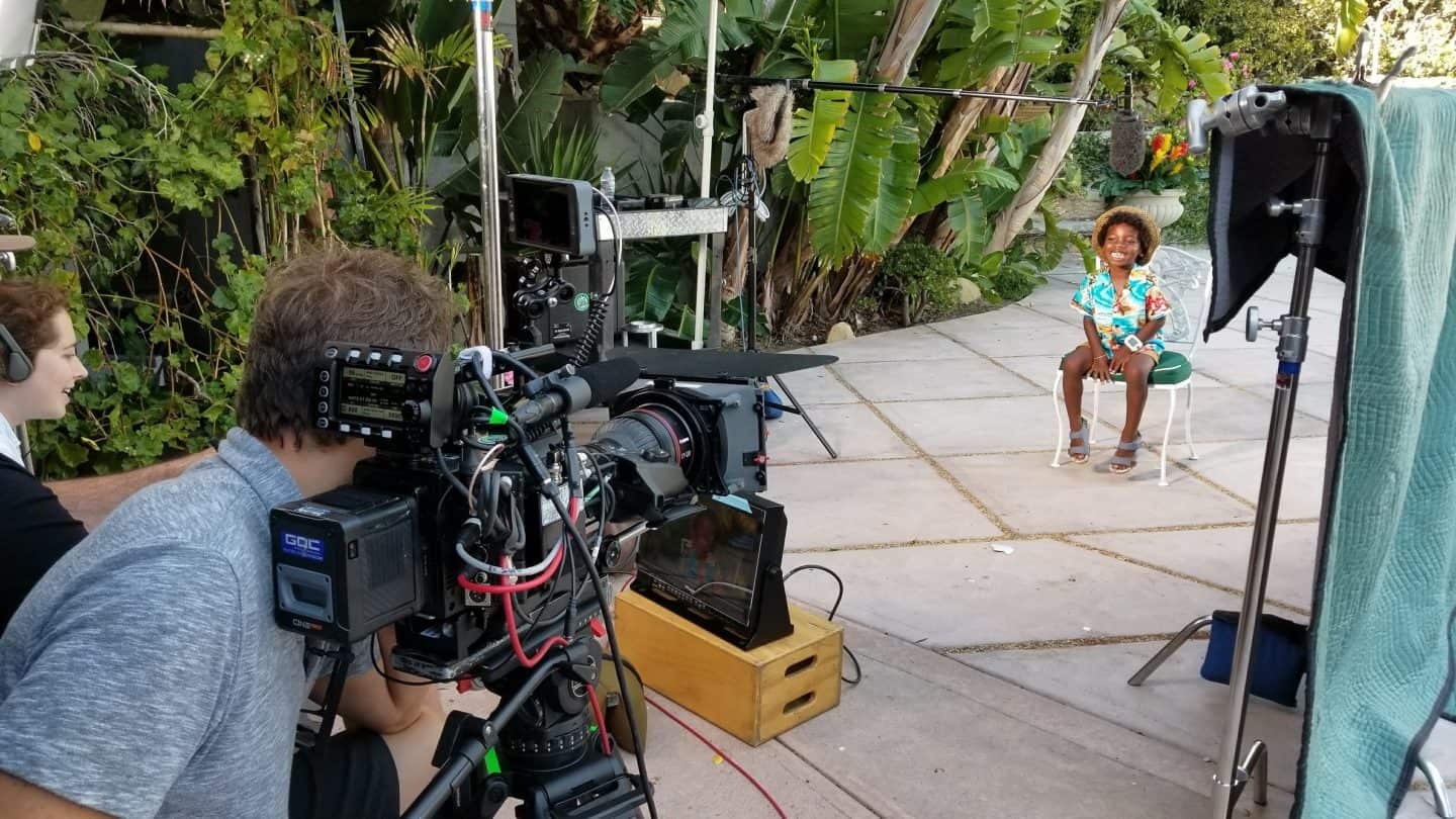 Boy model onset at Jimmy Kimmel with TV Cameras in a tropical setting