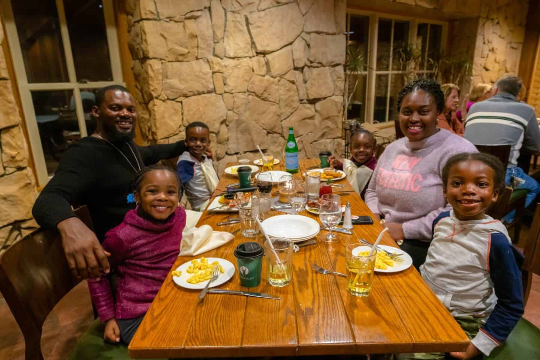 black family at dinner at deer valley ski resort utah