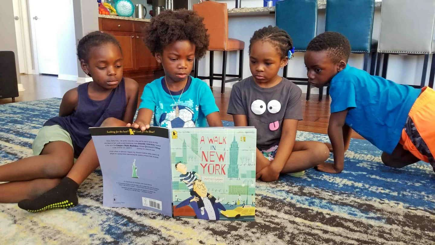 black kids reading a book