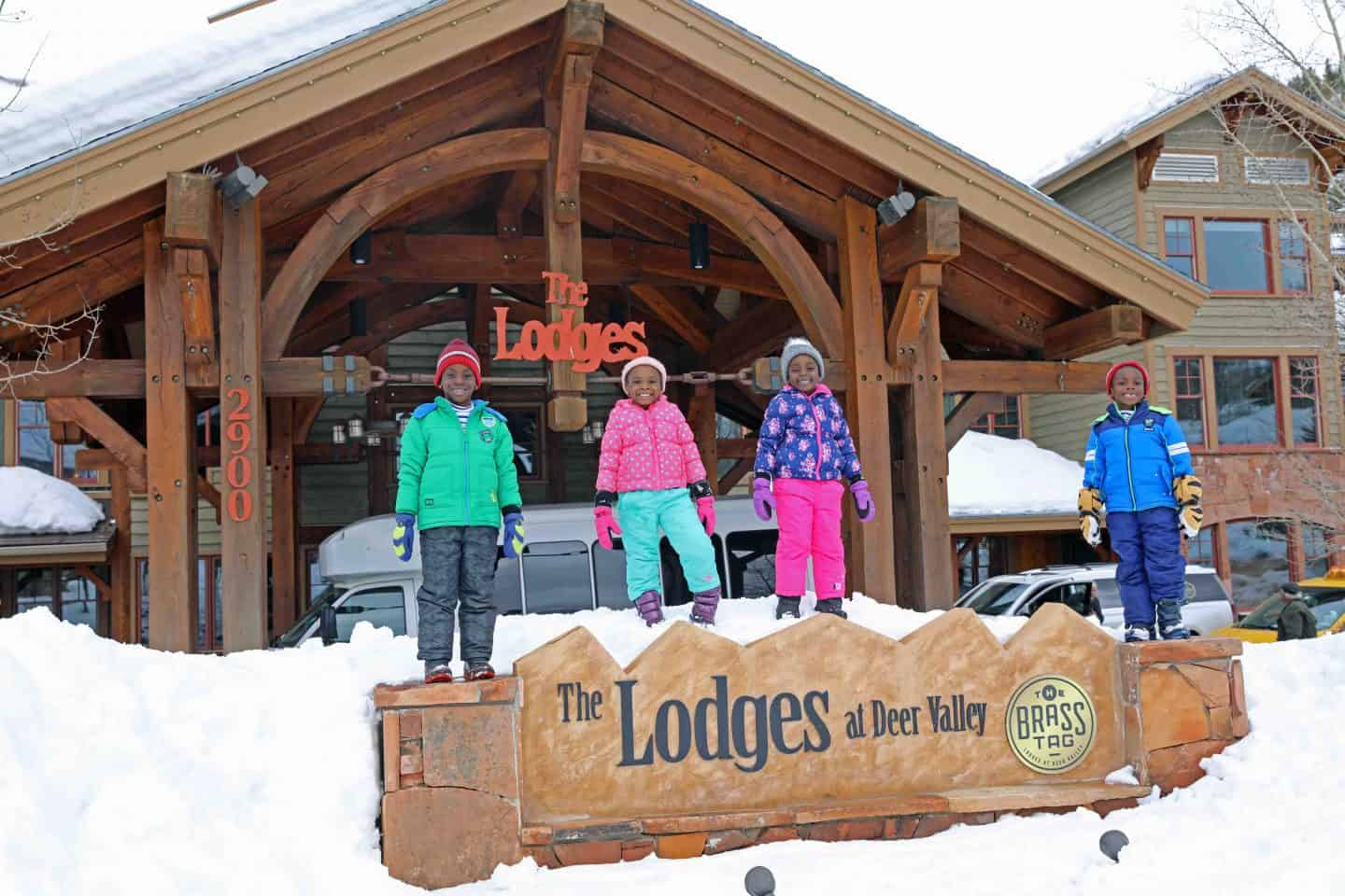 black kids standing in front of the lodges at deer valley