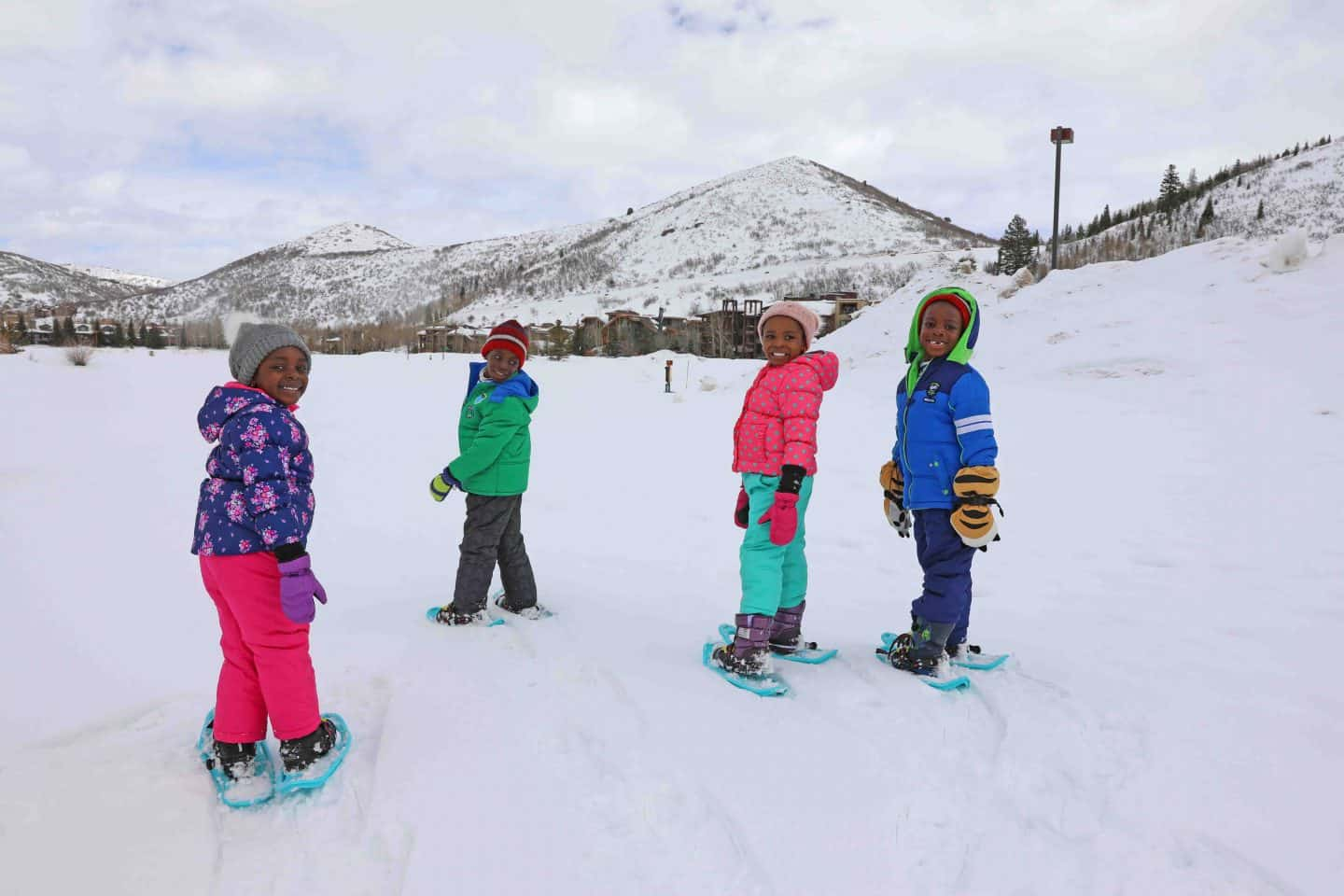 black kids travel and go snowshoeing