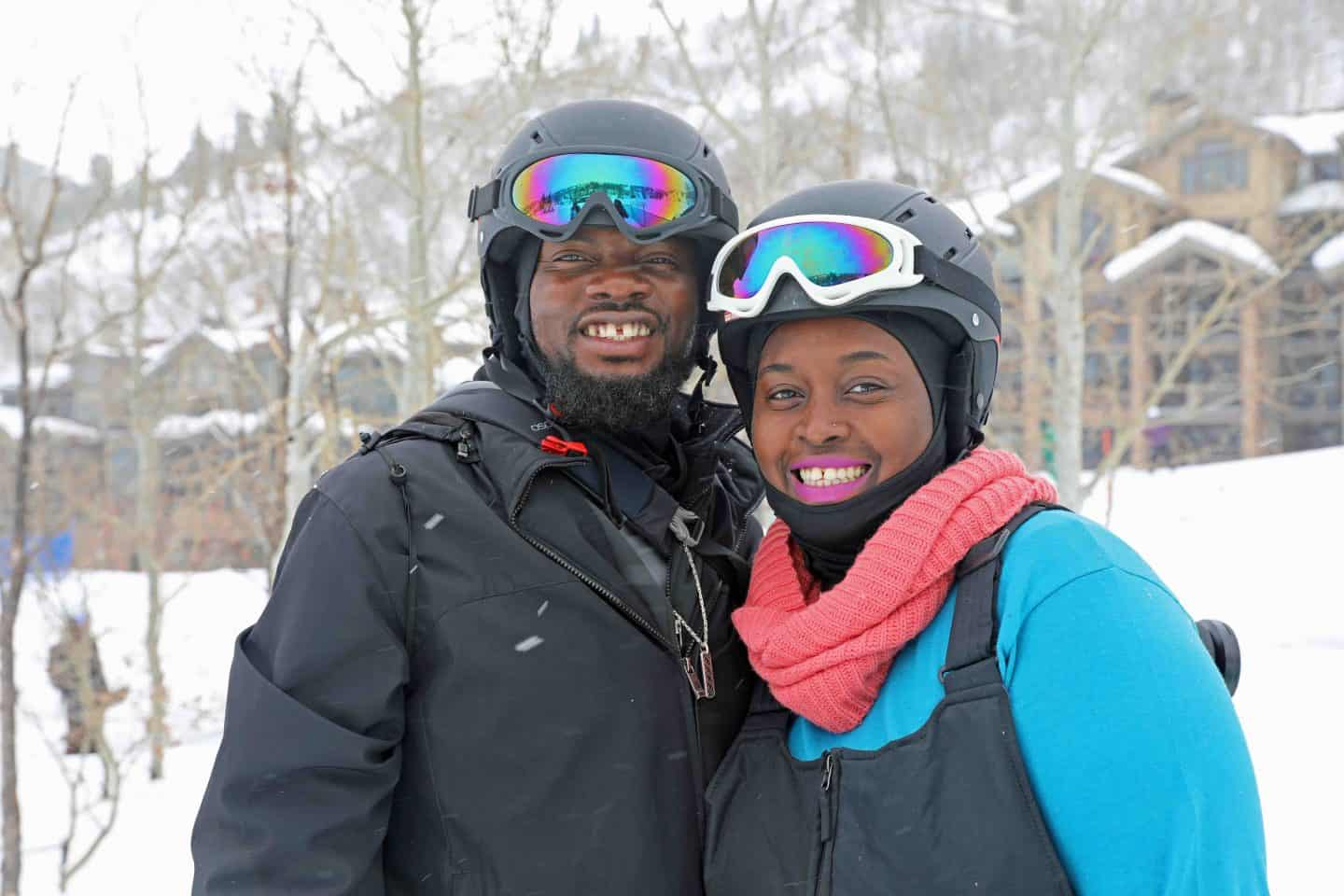 black man and woman in the snow