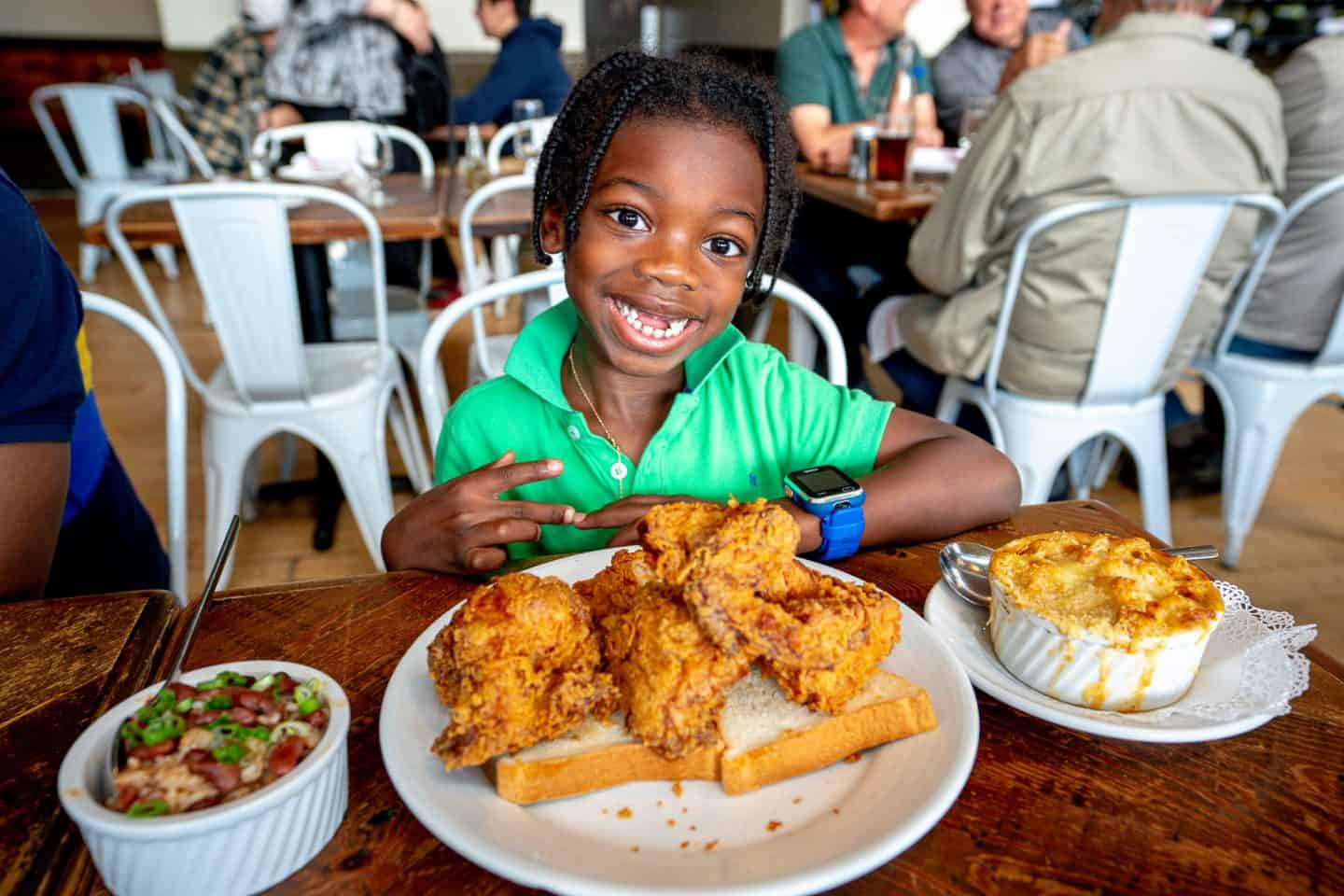 black kid eating friend chicken