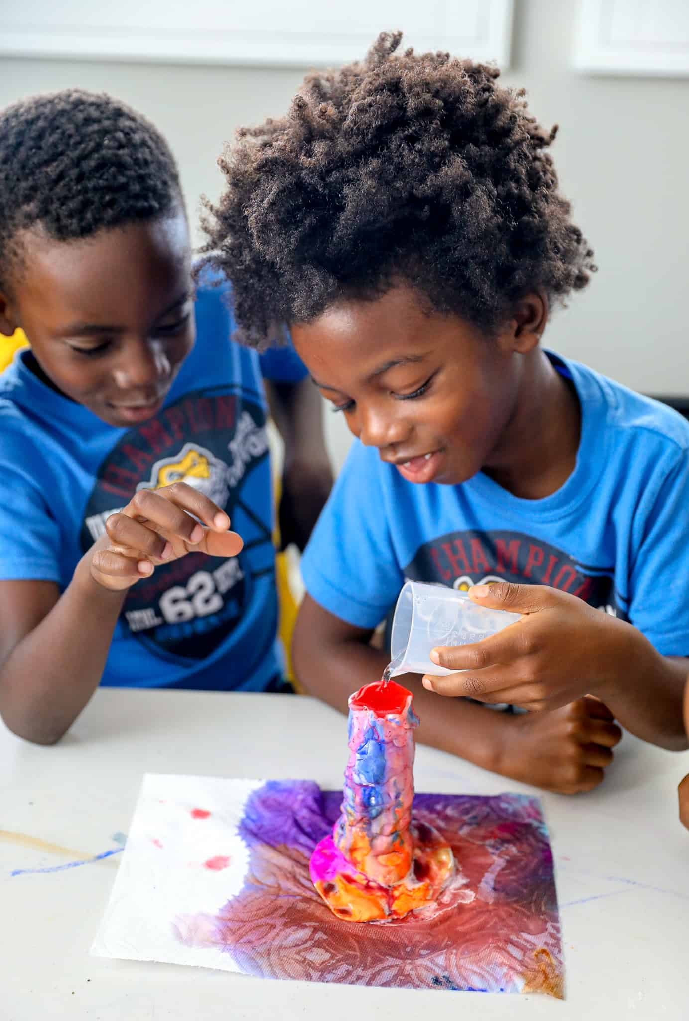 black kids doing a science experiment for homeschool