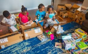 black kids opening boxes Subscription Boxes For Kids