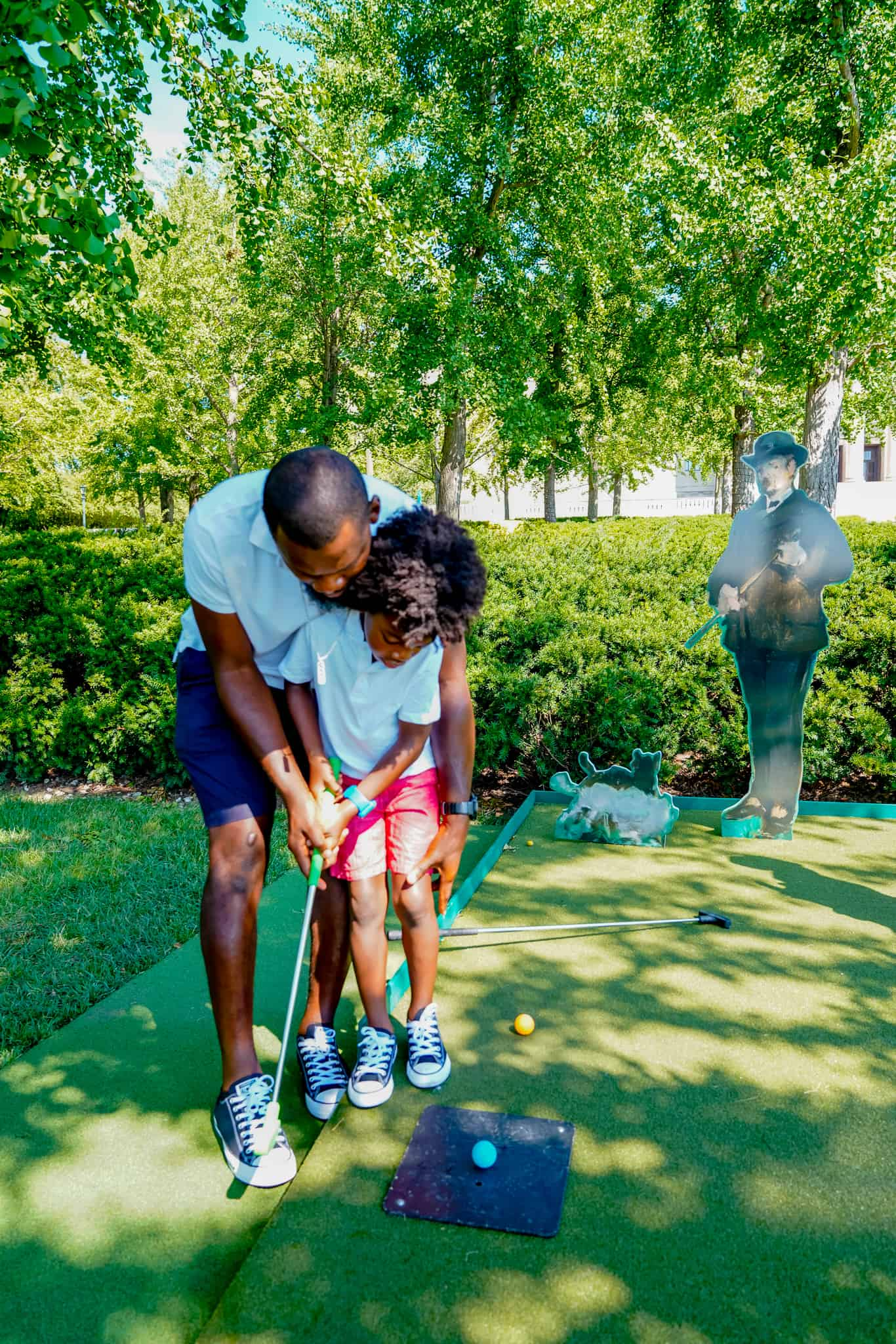 enjoying tee time with kids