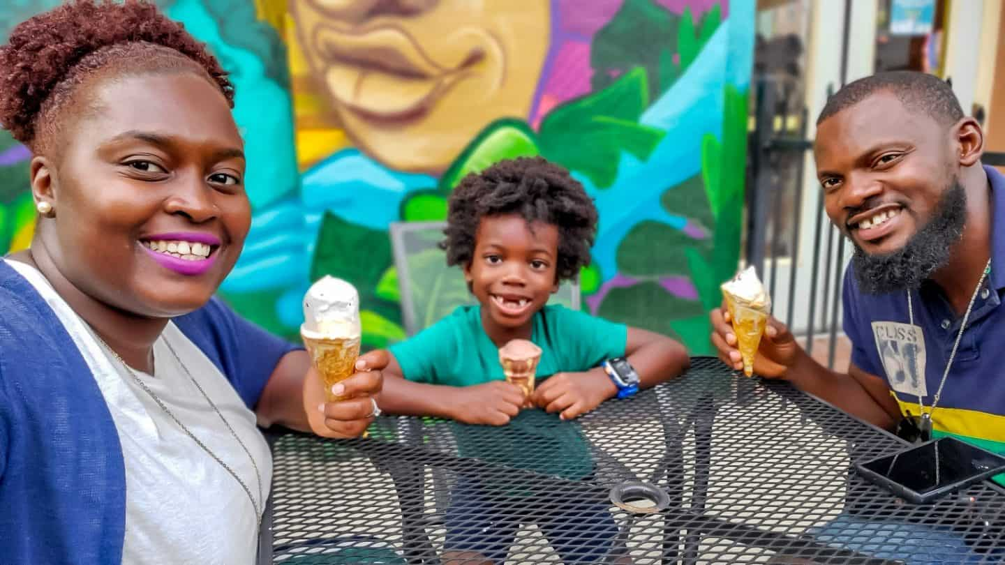 Enjoying ice cream with black family