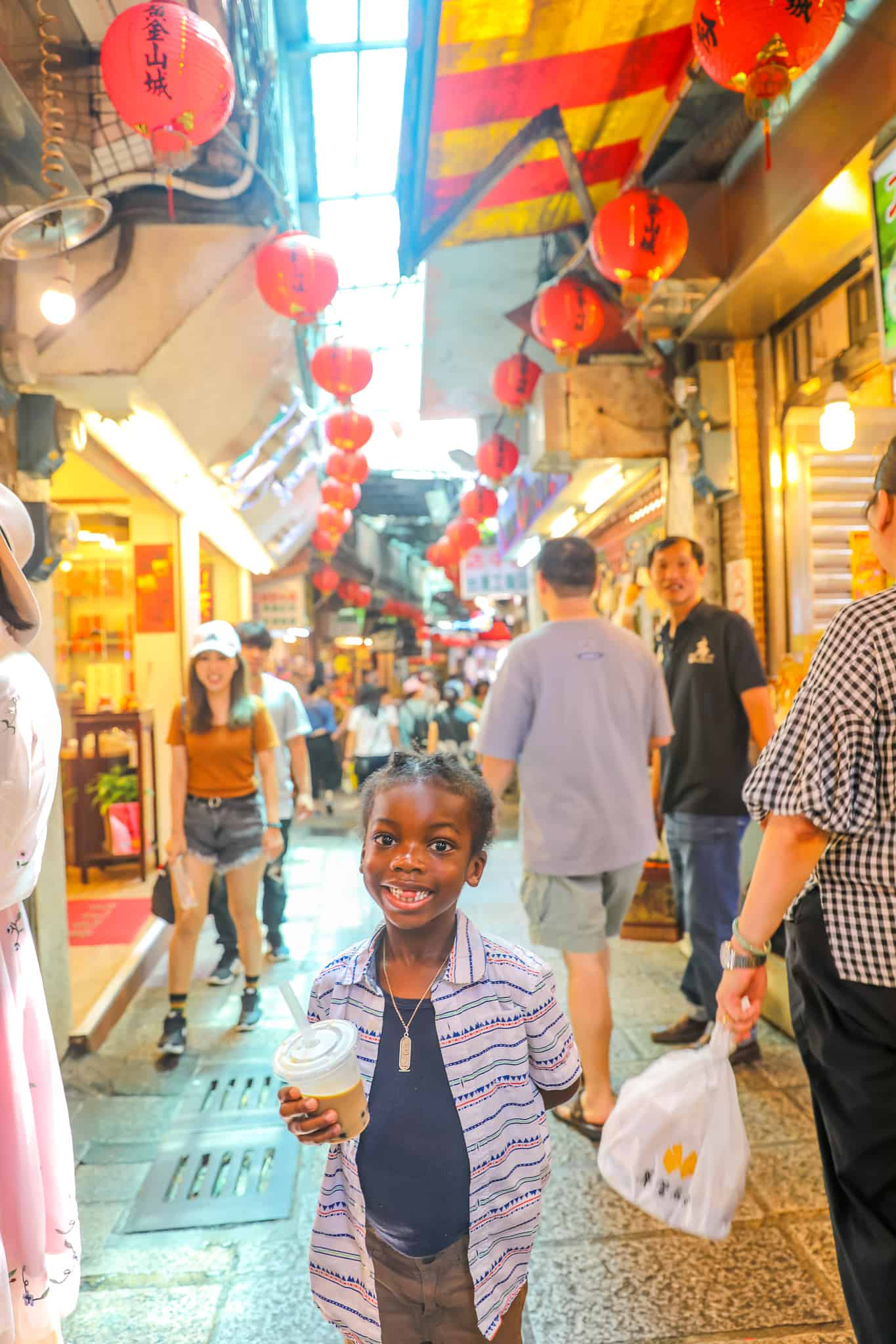 black kids enjoying at Jiufen Old Street