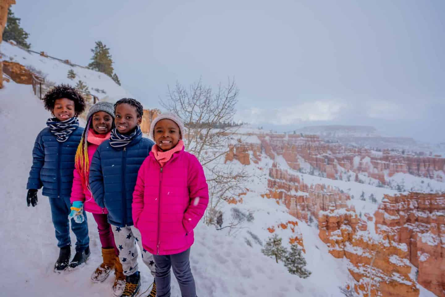 Children standing in front of a grand view at Bryce Canyon National Park.