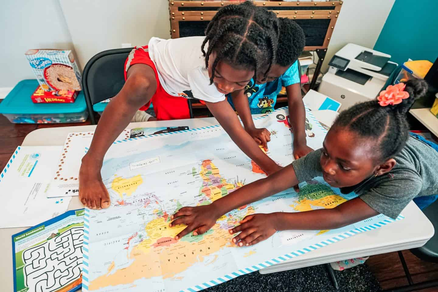 Teaching Your Kids Math, Social Studies, and English Skills Through Vacation Planning